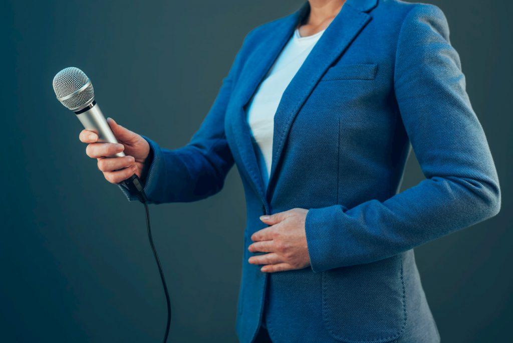 elegant-female-journalist-conducting-business